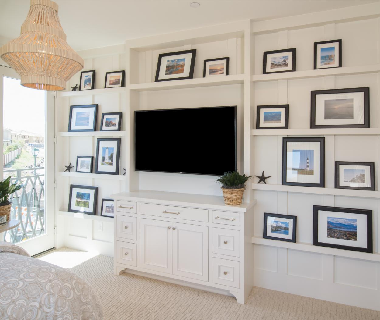 White Bedroom Entertainment Center with Open Shelves and a Beautiful Black Flat Screen TV
