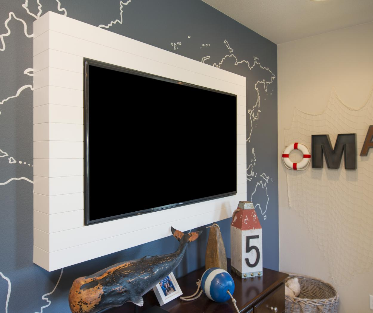 Beautiful White Beadboard Frame Surrounding a Black Flat Screen TV